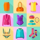 Ícones da roupa da mulher ajustados Fotografia de Stock