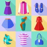 Ícones da roupa da mulher ajustados Fotos de Stock