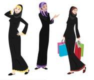 Ícones das mulheres de Khaliji em posições eretas ilustração stock