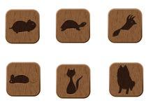 Ícones de madeira ajustados com silhuetas dos animais de estimação. Ilustração do Vetor