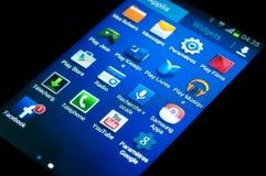 Ícones de Smartphone - smartphone da galáxia gt-S7390 G de Samsung Fotografia de Stock Royalty Free