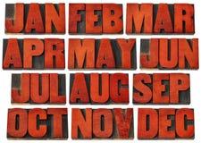 Ícones do calendário - meses no tipo de madeira Imagem de Stock Royalty Free