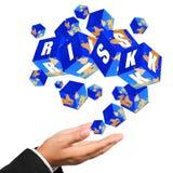 Ícones do cubo da gestão de riscos que fluem na mão Imagem de Stock