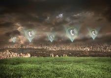 Ícones do telefone sobre a cidade Foto de Stock