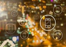 Ícones do telefone sobre a cidade Fotografia de Stock Royalty Free