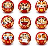Ícones dos desenhos animados da boneca de Daruma Fotografia de Stock Royalty Free