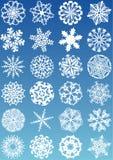 Ícones dos flocos de neve ilustração do vetor