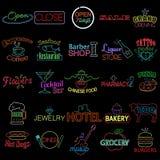 Ícones dos sinais de néon da loja Fotografia de Stock Royalty Free