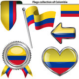Ícones lustrosos com a bandeira de Colômbia Fotos de Stock Royalty Free