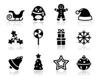 Ícones pretos do Natal com jogo da sombra Fotografia de Stock Royalty Free