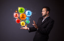 Ícones sociais da rede na mão de um homem de negócios Fotografia de Stock Royalty Free