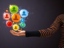Ícones sociais da rede na mão de uma mulher Imagem de Stock Royalty Free
