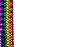 Ímã colorido das esferas na linha do arco-íris em um contexto branco Imagem de Stock Royalty Free