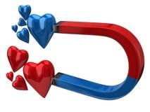 Ímã em ferradura que atrai corações Foto de Stock