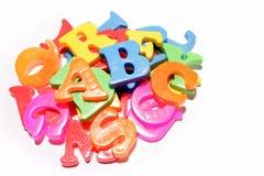 Ímãs coloridos do alfabeto Fotografia de Stock