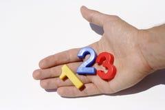 Ímãs do refrigerador do número na mão Foto de Stock Royalty Free