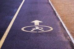 Índice de la zona peatonal en el pavimento Fotos de archivo