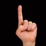 índice Una mano del ` s del hombre muestra un finger en un fondo negro foto de archivo