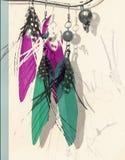 Αφηρημένη εικόνα μόδας με τα σκουλαρίκια φτερών στα τυρκουάζ και πορφυρά χρώματα στοκ εικόνες