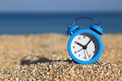 �larm clock on the beach Stock Images