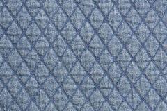 Γεμισμένο υπόβαθρο σύστασης στοιχείων υφασμάτων τζιν υφάσματος μπλε κοντά επάνω στοκ εικόνες