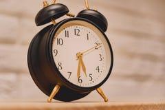 Εικόνα του εκλεκτής ποιότητας ξυπνητηριού στοκ εικόνα
