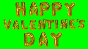 Ευτυχής ημέρα βαλεντίνων λέξης από τις χρυσές επιστολές μπαλονιών ηλίου που επιπλέουν στην πράσινη οθόνη - απόθεμα βίντεο