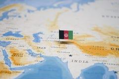 Η σημαία του Αφγανιστάν στον παγκόσμιο χάρτη στοκ φωτογραφία με δικαίωμα ελεύθερης χρήσης
