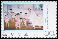Ιατρική εξέταση στον παιδικό σταθμό, σύγχρονα κορεατικά έργα ζωγραφικής serie, circa 1976 στοκ φωτογραφία με δικαίωμα ελεύθερης χρήσης
