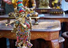 Ινδικό ειδώλιο Krishna αναμνηστικών με το φλάουτο στοκ εικόνες