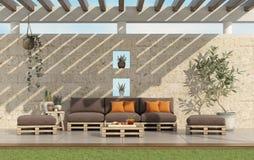 Κήπος με τον καναπέ παλετών με τον τοίχο πετρών στο υπόβαθρο απεικόνιση αποθεμάτων