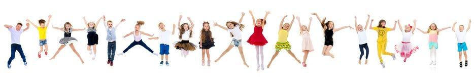 Κολάζ, ευτυχές άλμα παιδιών στοκ εικόνα