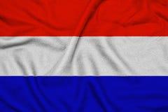 Κυματίζοντας σημαία των Κάτω Χωρών με τις της υφής πτυχές στοκ εικόνες