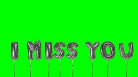 Λέξη σας χάνω από τις ασημένιες επιστολές μπαλονιών ηλίου που επιπλέουν στην πράσινη οθόνη - απόθεμα βίντεο
