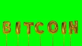 Λέξη Bitcoin από τις χρυσές επιστολές μπαλονιών ηλίου που επιπλέουν στην πράσινη οθόνη - φιλμ μικρού μήκους