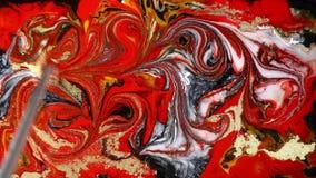 Μαρμάρινη psychedelic μετακίνηση Κόκκινο και χρυσός παραγωγή σχεδίων Ρευστό marbling τέχνης υπόβαθρο απόθεμα βίντεο