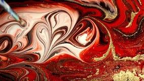 Μαρμάρινη psychedelic μετακίνηση Κόκκινο και χρυσός παραγωγή σχεδίων Ρευστό marbling τέχνης υπόβαθρο φιλμ μικρού μήκους
