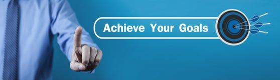 Ο Τύπος χεριών ατόμων επιτυγχάνει το κείμενο στόχων σας με ένα βέλος στόχων στοκ εικόνες