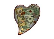 Διαμορφωμένος καρδιά κασσίτερος με τις δωρεές χρημάτων μέσα στοκ εικόνες