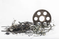 Metal gear. Μetal gear on a white background with metal filings Stock Image