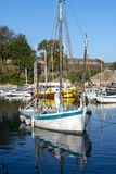 Fishing Boat moored in a French Port. France, ile d`Oléron, 2017-05, Sailing, pleasure craft, boat, docked. The Island off the coast of Franch is joined by a stock photo