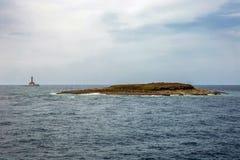 Île de phare Porer et de Fenoliga image stock