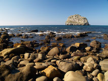 Île de roche d'Isla Villano image stock