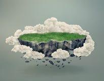 Île rocheuse couverte par l'herbe flottant dans l'entre le ciel et la terre Photos stock