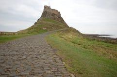 Île sainte le Northumberland de château de Lindisfarne photographie stock