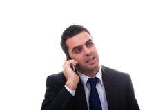 Îusinessman que fala em seu telefone móvel Fotografia de Stock