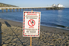 A �Warning - No Swimming� sign due to pollution at a Malibu beach, Malibu, California Stock Photo