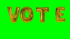 Ψηφοφορία λέξης από τις χρυσές επιστολές μπαλονιών ηλίου που επιπλέουν για την πράσινη οθόνη - απόθεμα βίντεο