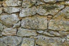 Τακτοποιημένα συσσωρευμένο τραχύ περικοπών πετρών υπόβαθρο σύστασης τοίχων άνευ ραφής στοκ εικόνες