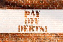Το γράψιμο κειμένων γραφής πληρώνει μακριά τα χρέη Η έννοια που σημαίνει την πληρωμή για το πράγμα εσείς έχει στο τούβλο επενδύσε απεικόνιση αποθεμάτων